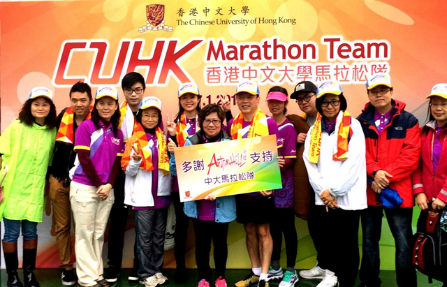 Mr. and Mrs. Sin (5th and 6th from right) at the Standard Chartered Hong Kong Marathon