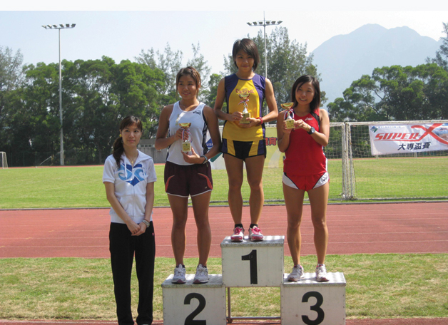 Nurses are trained to be brisk walkers, but few come close to her in terms of being light-footed. Miss Yu Kit-ching (2nd right), a Year 3 Nursing Student, won the woman's individual championship for the second year running in the Annual Cross Country Meet of the University Sports Federation of Hong Kong.
