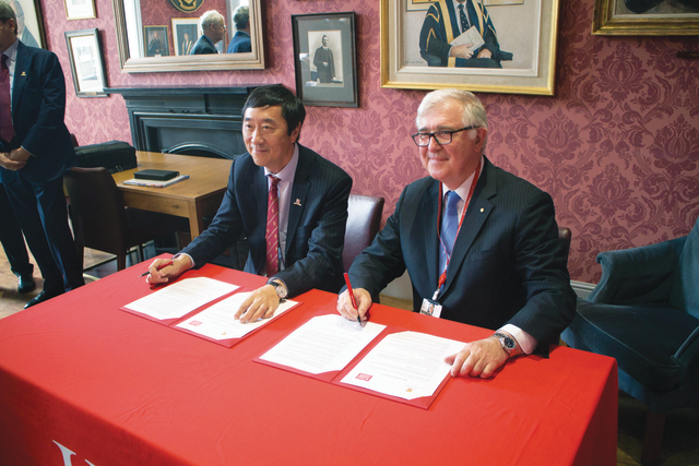 Prof. Joseph Sung (left) and King's President Prof. Ed Byrne AC sign a Memorandum of Agreement