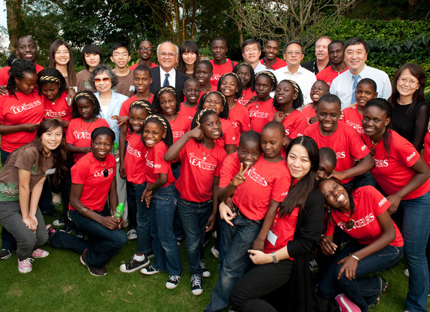 The Watoto Children's Choir, made up of children orphaned by AIDS or warfare in Uganda, was in Hong Kong to take part in S.H. Ho College's celebration of its fourth anniversary in October 2010. Here the children were seen having a good time in the garden of the Vice-Chancellor.