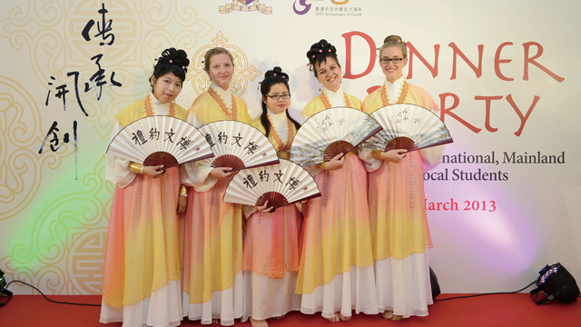 Incoming exchange students perform traditional Chinese fan dance at a dinner party for local and overseas students