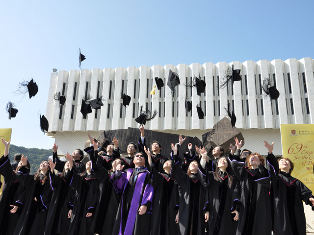 Master's degree graduates throw their mortar boards at the 69th Congregation.