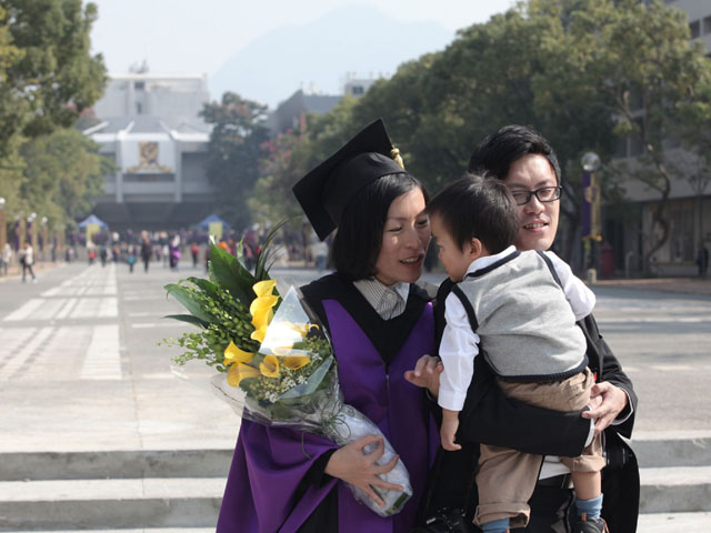 The 70th Congregation for the Conferment of Degrees<br><br>Little gentleman sweetly greets PhD graduate of 2011.