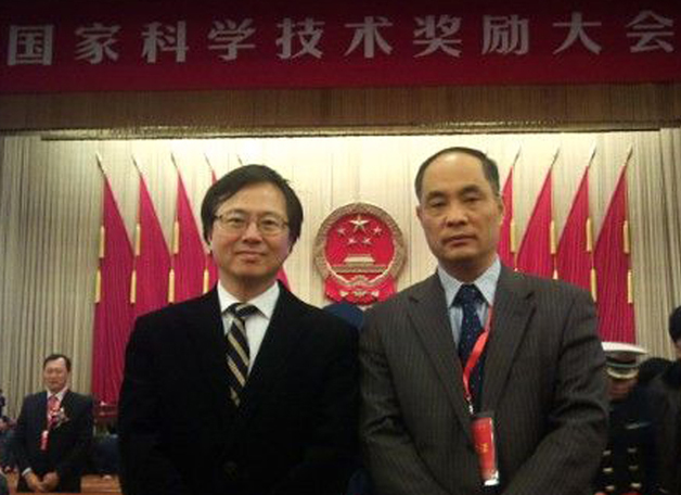 Two CUHK scientists, Prof. Huang Jie (right) and Prof. Poon Wai-sang, were in the Great Hall of the People in Beijing in January 2011 to receive prizes from the National Office for Science and Technology Awards for the research projects they led.