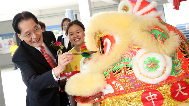 A series of events to celebrate the 56th Anniversary of United College—UC run, Outdoor Bazaar, birthday party and 'Feast-for-a-Thousand' Dr. Thomas H.C. Cheung, Chairman of the United College Board of Trustees, dotting the eyes of lion at the birthday party